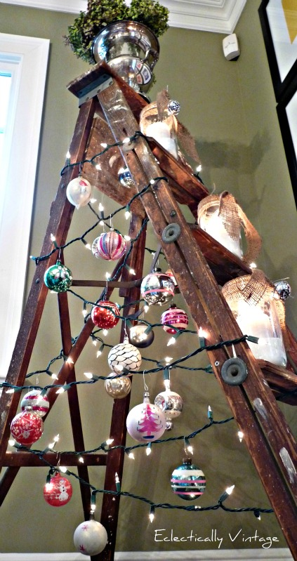 Creative Christmas Decorating Ideas - love this ladder Christmas tree strung with lights and candles kellyelko.com