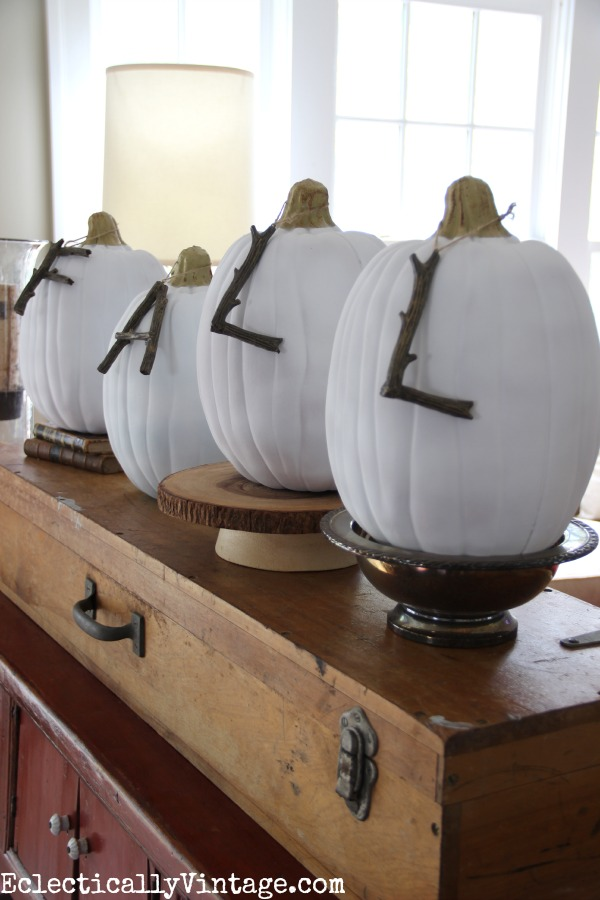Fall Home Tour - love these white pumpkins spelling out fall in twig letters kellyelko.com