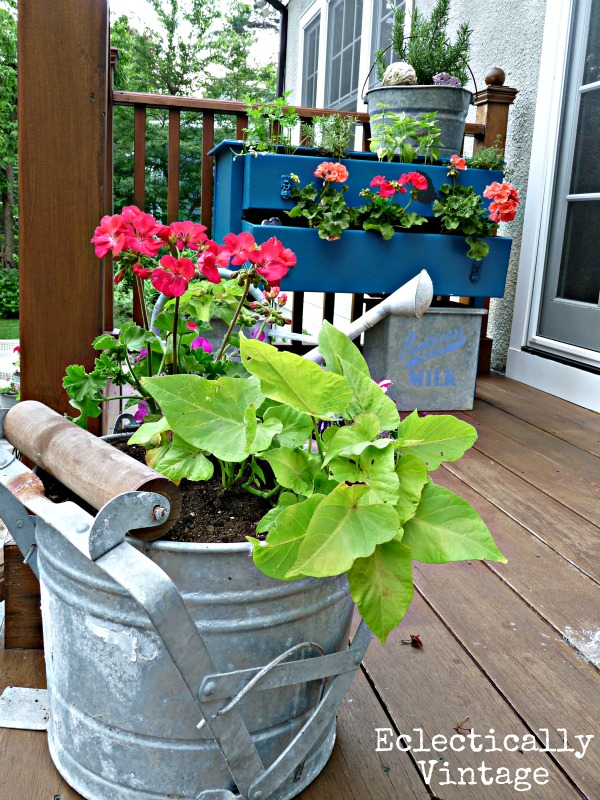 Unique garden containers with a mop bucket planter for Outdoor planter ideas