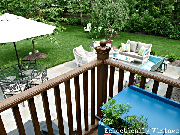Eclectic patio - love the mixture of new and vintage pieces and the creative planters!  kellyelko.com