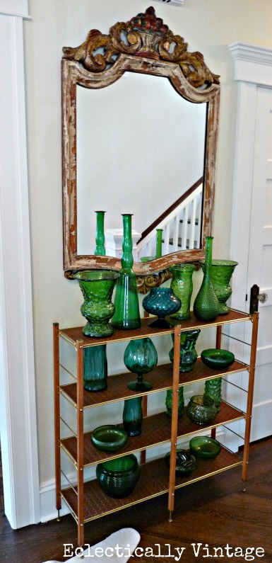 Amazing vintage green glass collection in this beautiful entryway - kellyelko.com