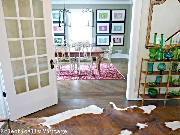 Gorgeous foyer leading into colorful dining room - kellyelko.com