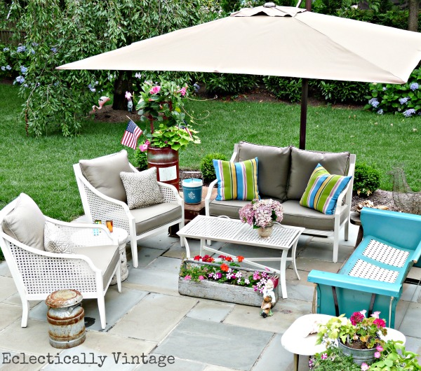 Eclectic outdoor patio - love the vintage blue glider kellyelko.com