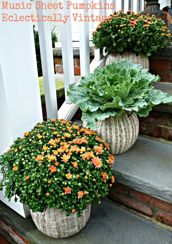 Fall Porch Decorating - tons of great DIY ideas here like these music sheet pumpkin planters!  kellyelko.com