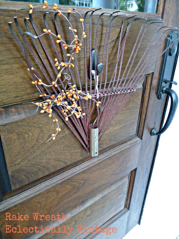 Fall Porch Decorating - tons of great DIY ideas here like this rake wreath!  kellyelko.com