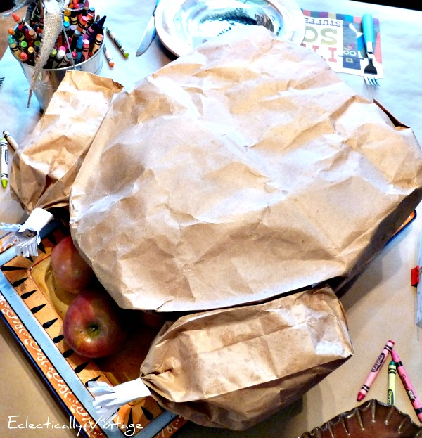Thanksgiving Crafts for Kids - how to make a paper bag Thanksgiving turkey with a popcorn surprise inside kellyelko.com #thanksgiving #thanksgivingcrafts #fallcrafts #thanksgivingdecor #thanksgivingcenterpiece #kidscrafts #diythanksgiving