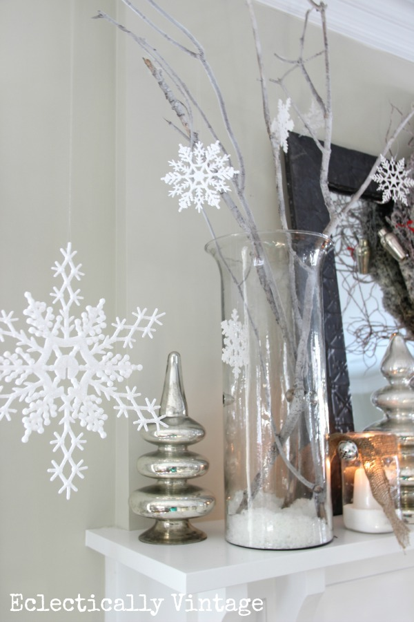 Christmas House Tours - step inside this 100 year old home filled with tons of fabulous decorating ideas like these snowflakes!  kellyelko.com