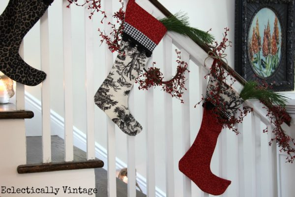 Christmas House Tours - step inside this 100 year old home filled with tons of fabulous decorating ideas like this stocking bannister!  kellyelko.com
