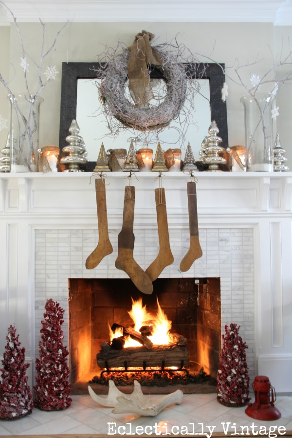Christmas House Tours - step inside this 100 year old home filled with tons of fabulous decorating ideas like this white mantel!  kellyelko.com