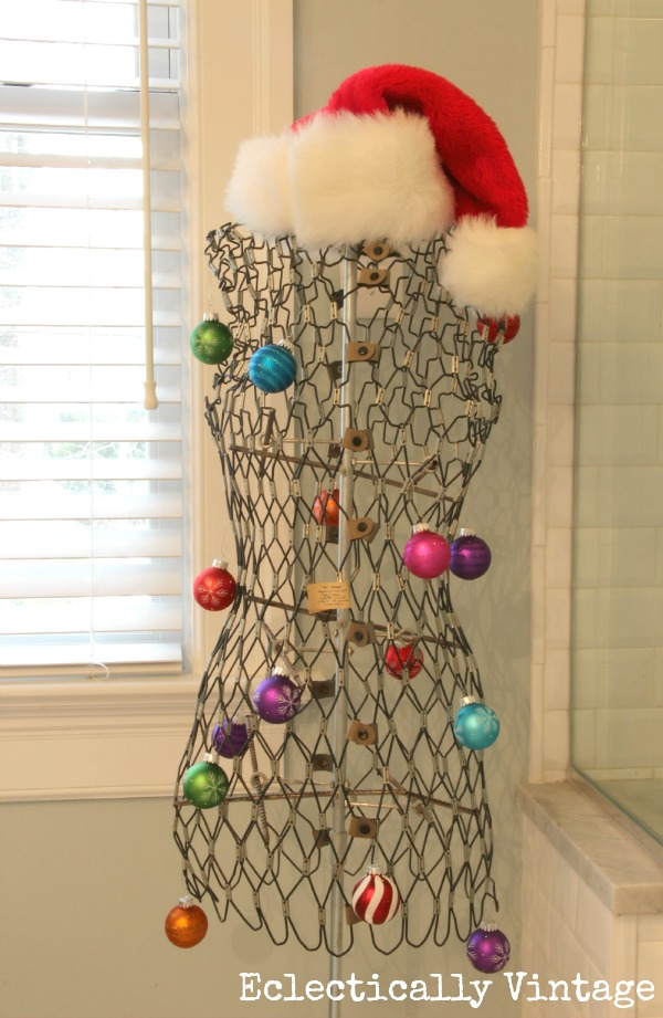 Creative Christmas decorating ideas - vintage dress form filled with ornaments kellyelko.com