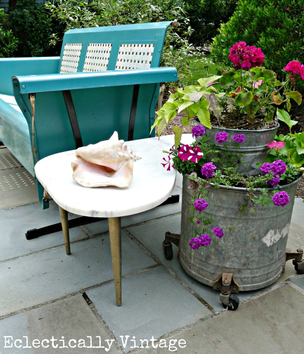 Love the old blue porch glider and galvanized bucket planters kellyelko.com