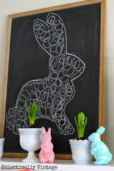Chalkboard bunny on this fun spring mantel kellyelko.com #chalkart #sprigdecor #easterdecor