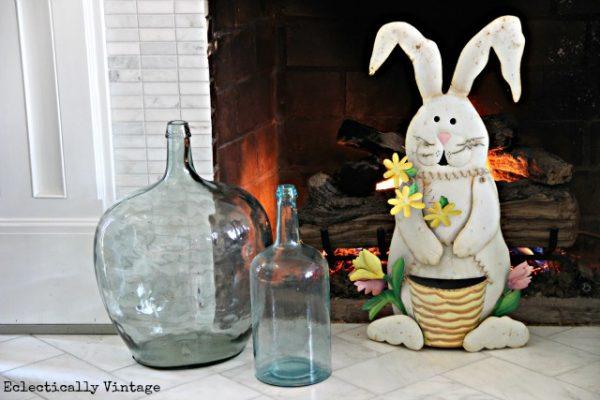 Easter Mantel - love the demijohns kellyelko.com #springdecor #easterdecor