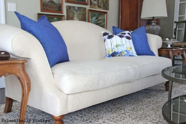 Eclectically Vintage decorating with blue Crate and Barrel pillows
