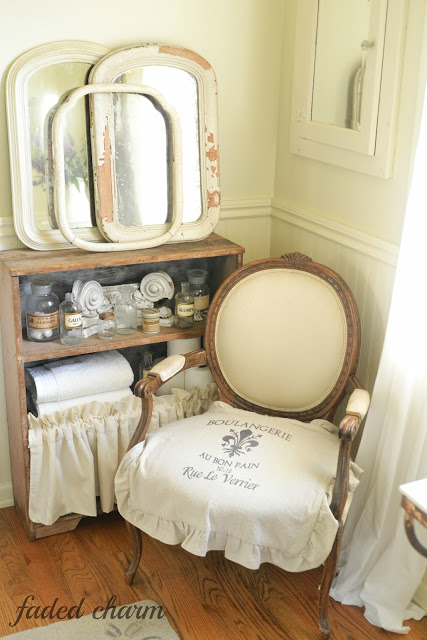 Cottage bathroom - love the mirror collection