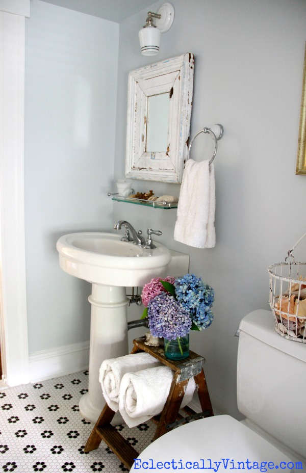 Vintage bathroom - love the floor and color (and that cute ladder)!  kellyelko.com
