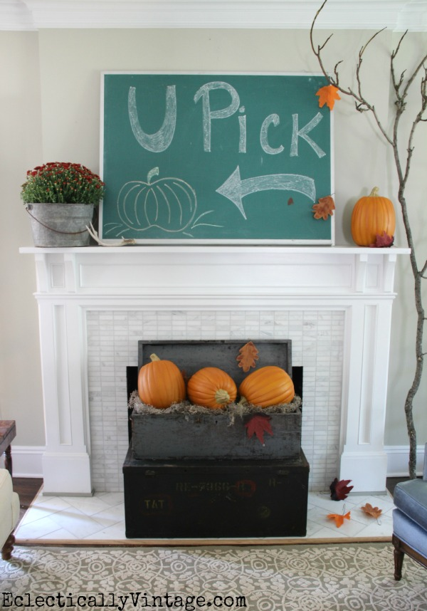 8 Creative Fall Mantel Decorating Ideas - love this giant chalkboard pumpkin patch art and pumpkins in an old wood crate kellyelko.com #fall #falldecor #falldecorating #fallmantel #manteldecor #farmhousestyle #farmhousedecor #pumpkins #chalkart