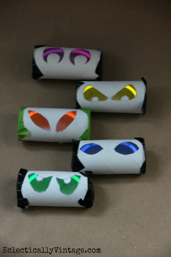 How to make glow stick eyes at eclectically vintage for Glow sticks in toilet paper rolls