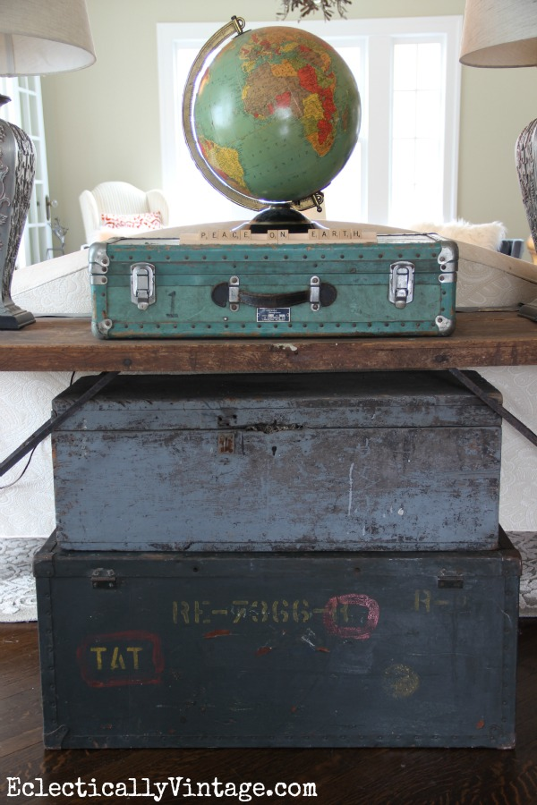 Vintage Christmas decorating ideas - love this pile of old trunks that create a Christmas tree kellyelko.com #vintagedecor #vintagechristmas #vintagestyle #farmhousedecor #kellyelko