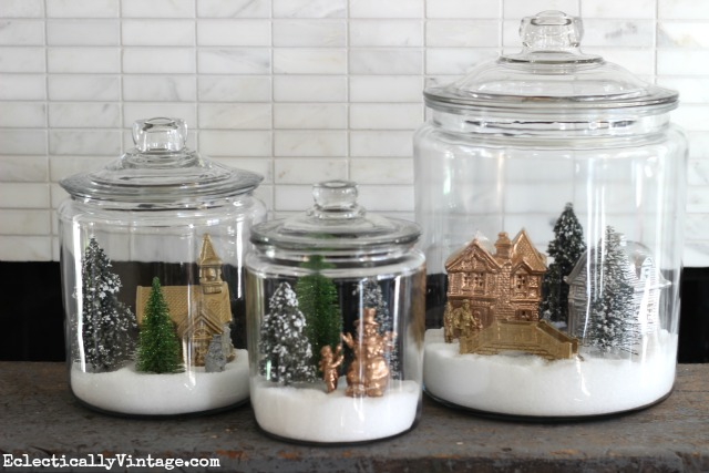 Creative Christmas Little Houses Decorating Ideas - I love these little winter village jars kellyelko.com #christmasdecor #christmasdiy #diychristmas #christmascrafts #christmashouses #christmasvillage #christmasdecorating #christmasjars #kellyelko
