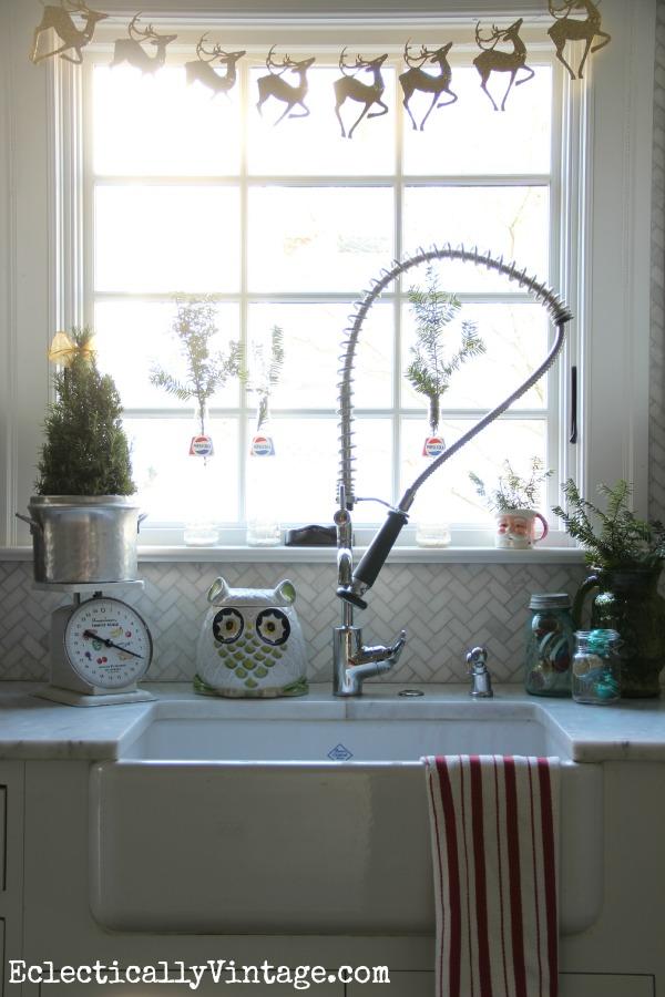 Christmas kitchen - love the glittery reindeer banner!  kellyelko.com