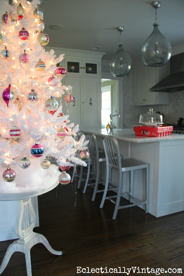 Flocked white Christmas tree in this fun kitchen kellyelko.com
