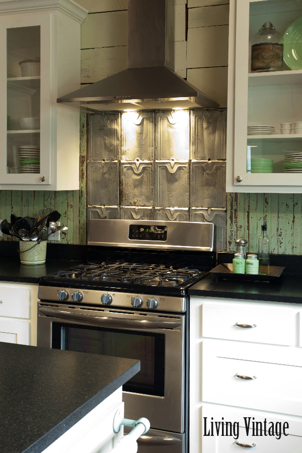 Metal backsplash adds a vintage touch to this kitchen