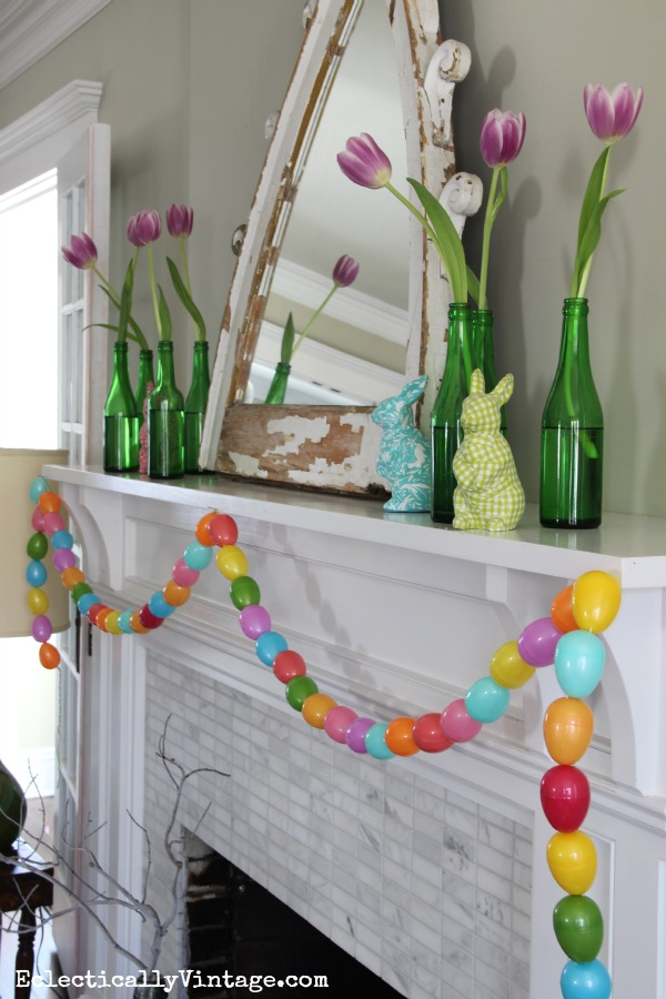 Love the DIY egg garland on this fun spring mantel kellyelko.com