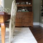 Beautiful dining room and love the pieced cowhide rug! kellyelko.com