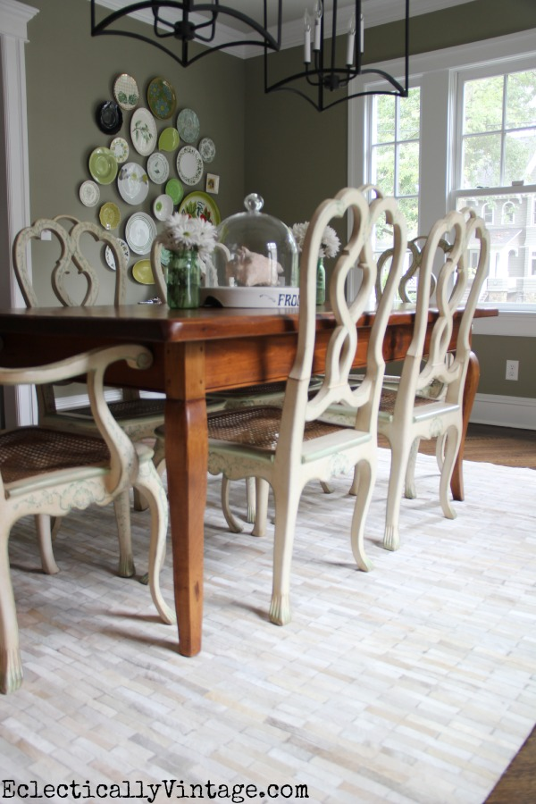 Love the pieced cowhide in this eclectic dining room kellyelko.com