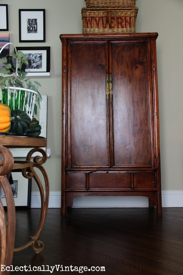 Asian armoire - love the old baskets stacked on top kellyelko.com