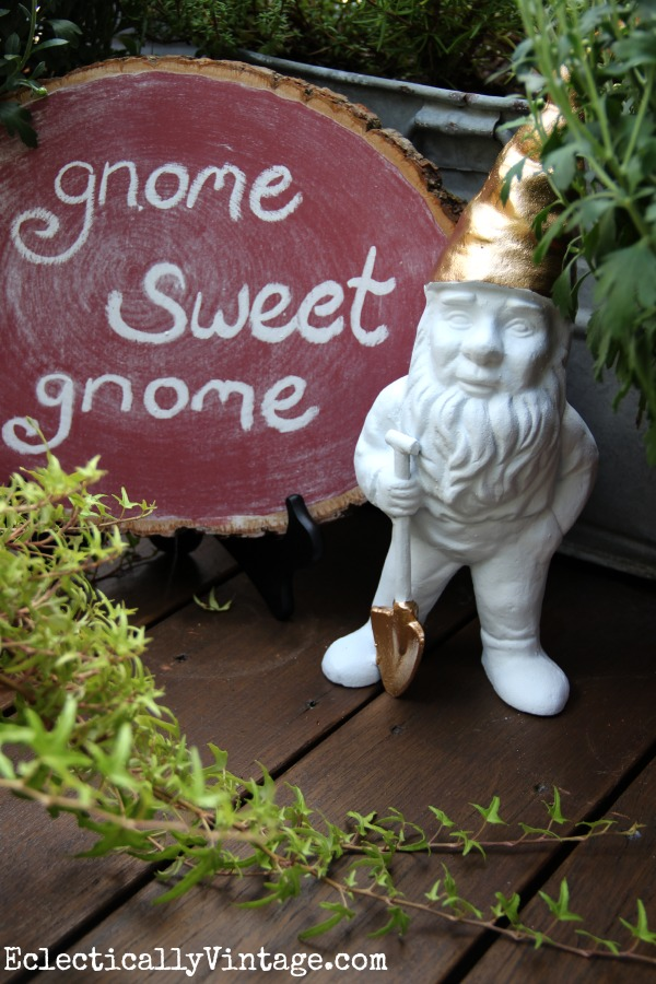 Make a log slice chalkboard in this very unique color!  She made the gold topped gnome too! kellyelko.com