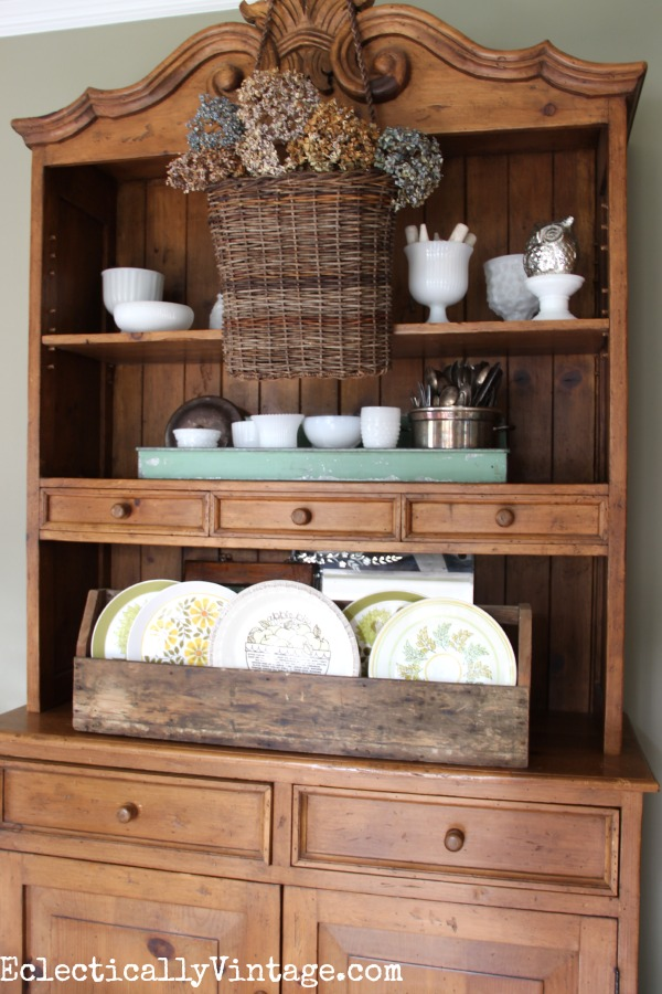 Layer a hanging basket over your shelves or dining hutch kellyelko.com #EclecticallyFall