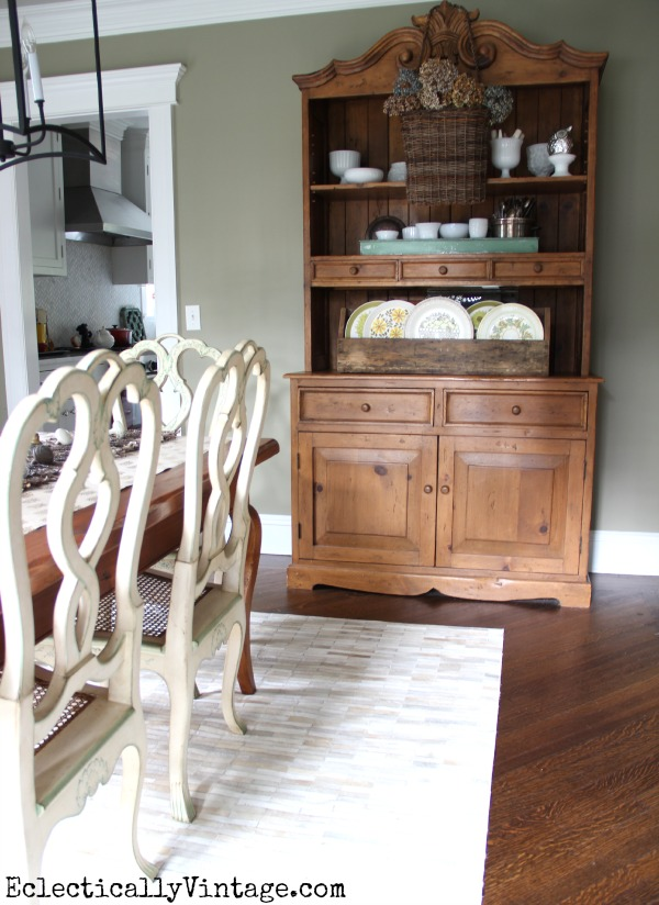 Love this dining room hutch filled with beautiful collections kellyelko.com #EclecticallyFall