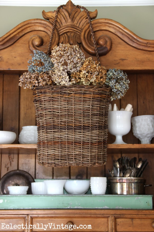 This hanging basket filled with dried hydrangeas is gorgeous! kellyelko.com #EclecticallyFall