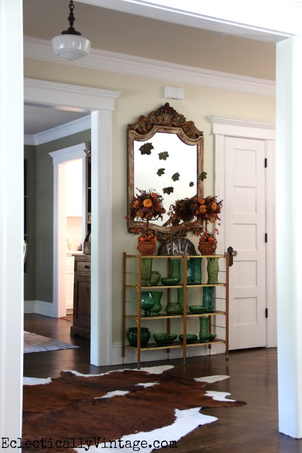 What a fun fall foyer - love the falling leaves on the mirror kellyelko.com #EclecticallyFall