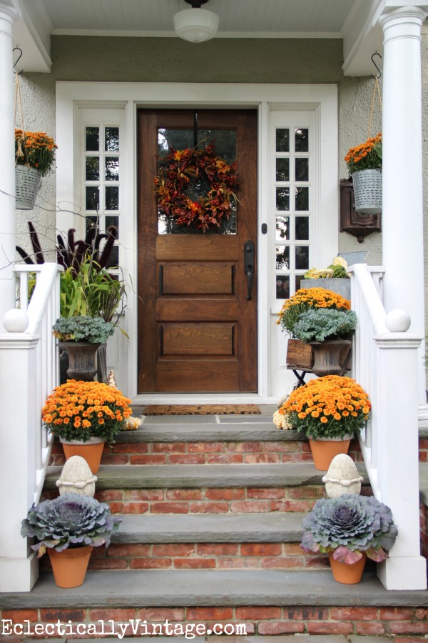 I love this welcoming fall porch - such great details. kellyelko.com