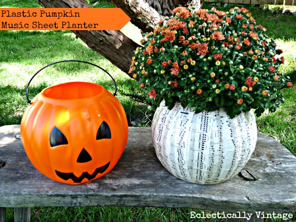 Music sheet pumpkin planter - one of 8 creative ideas to transform those ugly pumpkin pails! kellyelko.com #fall #falldecor #mums #pumpkindecor #fallcrafts #halloweencrafts #modpodge #mumdecor #falldiy #pumpkincrafts