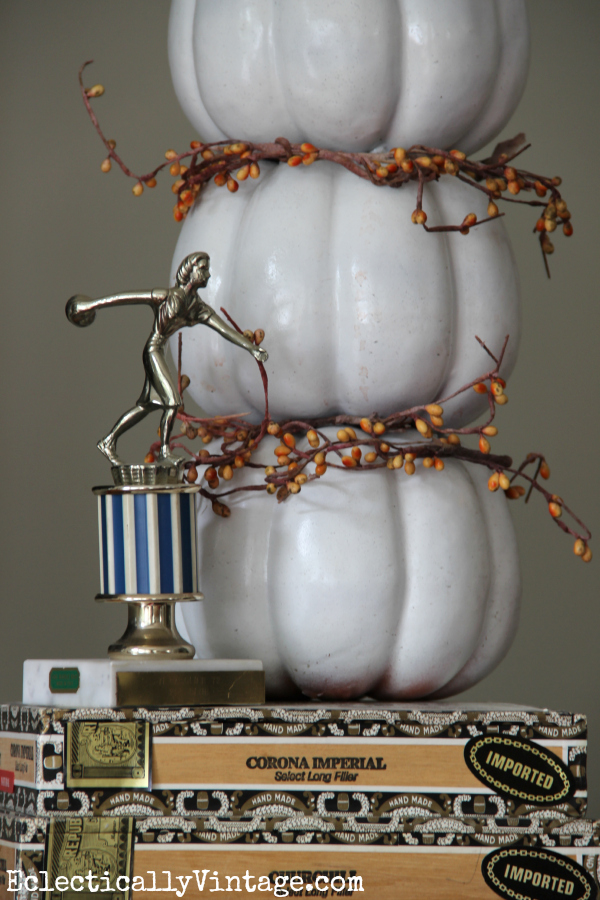 Cute pumpkin topiary - love it propped on the old cigar boxes kellyelko.com #EclecticallyFall