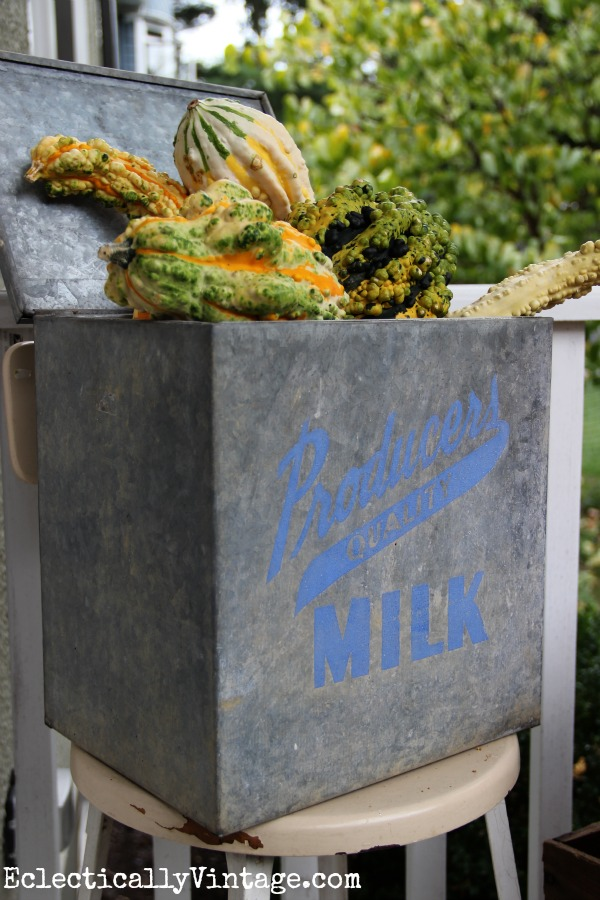 Cute vintage milk box filled with gourds for fall - such a fun fall porch eclectiallyvintage.com