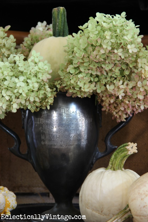 Vintage trophy filled with hydrangeas and pumpkins - such a creative fall home kellyelko.com