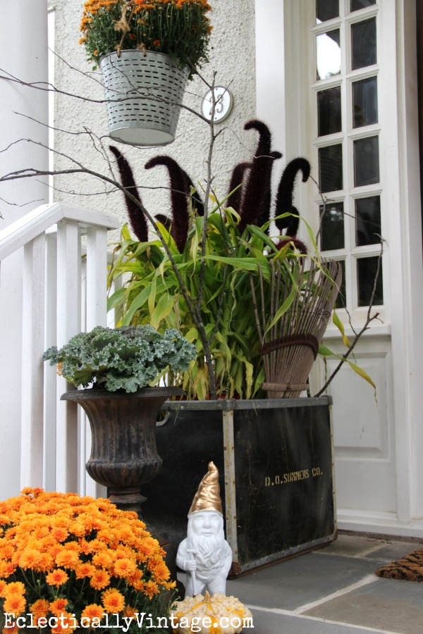 I love this fall porch! That huge planter with the cool plant is amazing! kellyelko.com