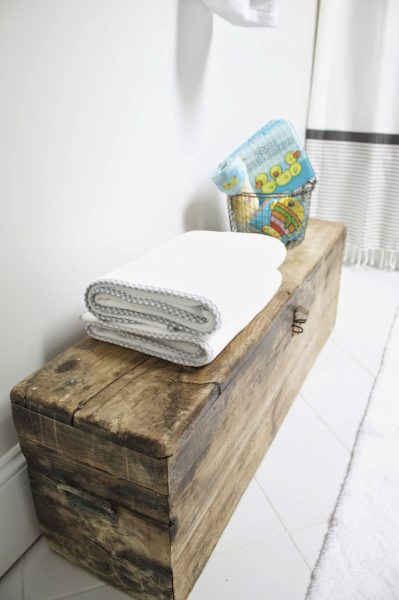 A big wooden toolbox is perfect for bathroom storage kellyelko.com