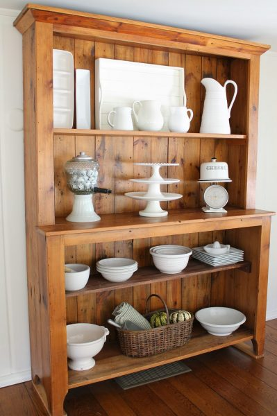 Beautiful hutch displays white bowls, platters and cake stands kellyelko.com