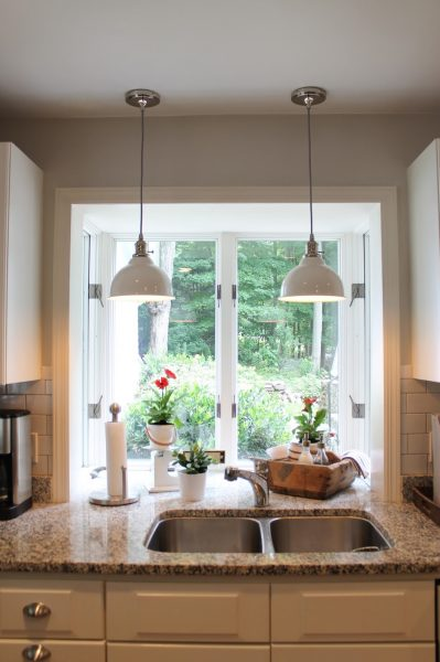Love the enamel double pendant lights over the kitchen sink kellyelko.com