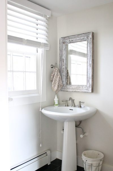 Love the rustic wood mirror in this powder room kellyelko.com