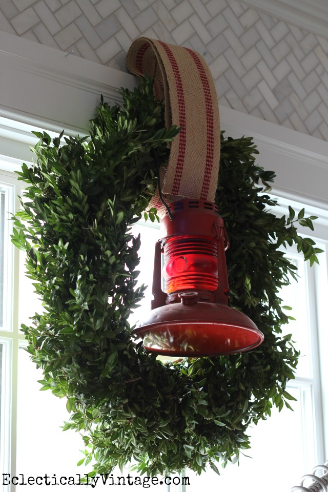 Boxwood wreath is festive with an old red lantern kellyelko.com