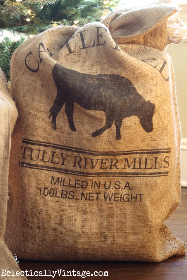 Love this cattle feed grain sack under the Christmas tree kellyelko.com
