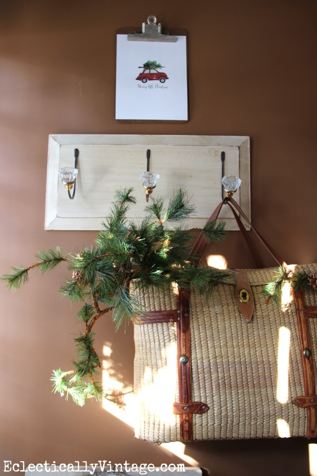 Vintage basket filled with greenery - the perfect winter Christmas touch kellyelko.com