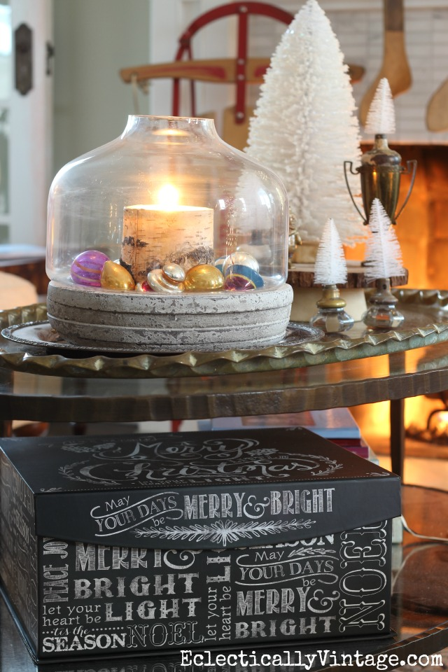 Love this Christmas coffee table - the candle and ornament filled terrarium kellyelko.com